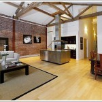 Exposed Brick And Trusses (And Big Window To Expose Yourself)